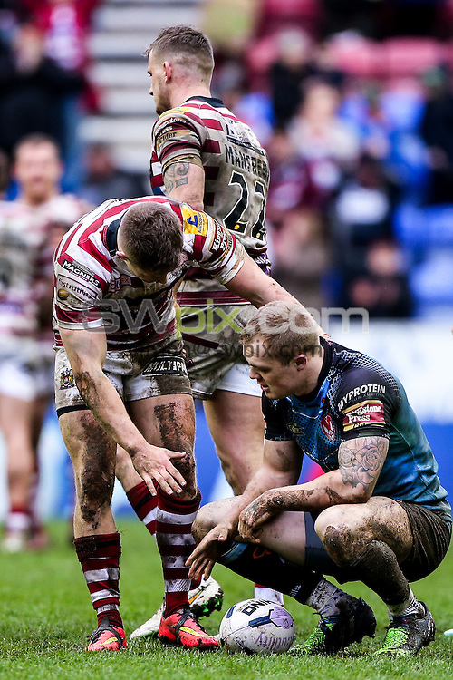 Picture by Alex Whitehead/SWpix.com - 03/04/2015 - Rugby League - First Utility Super League - Wigan Warriors v St Helens - DW Stadium, Wigan, England -Wigan's Ryan Hampshire consoles St Helens' Adam Swift.