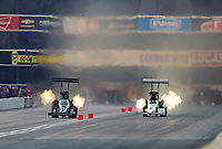 Nov 10, 2018; Pomona, CA, USA; NHRA top fuel driver Shawn Reed (left) alongside Audrey Worm during the Auto Club Finals at Auto Club Raceway. Mandatory Credit: Mark J. Rebilas-USA TODAY Sports