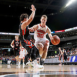 SIOUX FALLS, SD - MARCH 19: Ty Smith #30 from Washington has his path to the basket cut off by Houstyn Heinz #10 from Huron in the first half of their quarterfinal game Thursday afternoon during the Boys State AA Basketball Tournament at the Denny Sanford Premire Center in Sioux Falls, SD. (Photo by Dave Eggen/Inertia)
