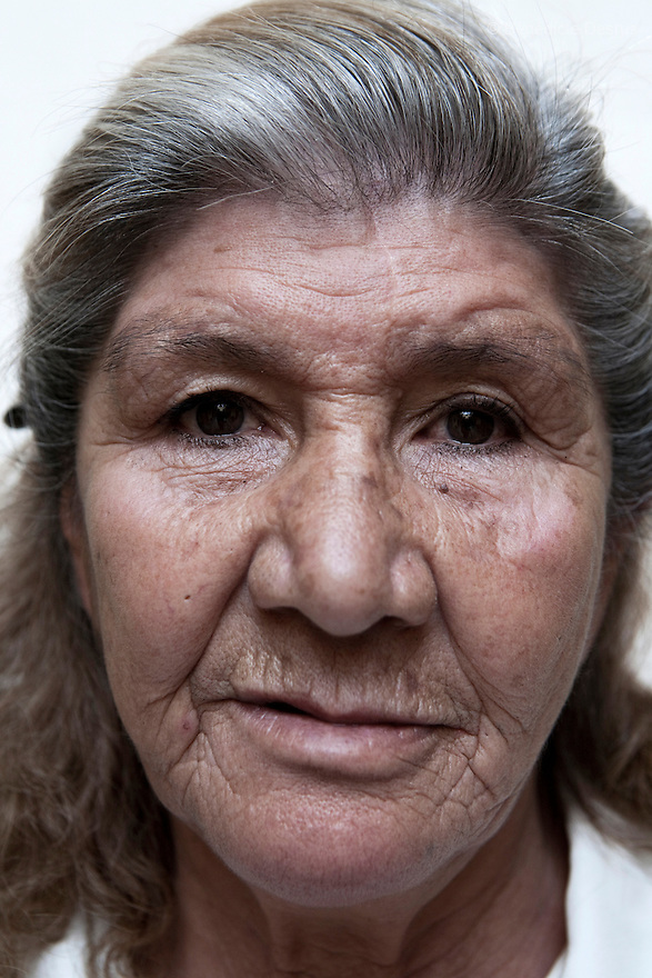 Portrait of Gloria, a resident of Casa Xochiquetzal, at the shelter in Mexico City on March 14, 2008. Casa Xochiquetzal is a shelter for elderly sex workers in Mexico City. It gives the women refuge, food, health services, a space to learn about their human rights and courses to help them rediscover their self-confidence and deal with traumatic aspects of their lives. Casa Xochiquetzal provides a space to age with dignity for a group of vulnerable women who are often invisible to society at large. It is the only such shelter existing in Latin America. Photo by Bénédicte Desrus