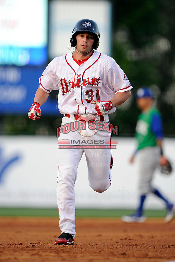 Right fielder Bo Greenwell (31) of the Greenville Drive runs the bases after hitting his second home run of the game against the Asheville Tourists on Wednesday, April 23, 2014, at Fluor Field at the West End in Greenville, South Carolina. (Tom Priddy/Four Seam Images)