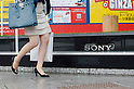May 10, 2012, Tokyo, Japan - A business woman walks past the Sony Building in downtown Tokyo. Sony Corp. reports an annual net loss of 457 billion yen (approximately $5.7 billion US Dollars) in FY 2011. This is Sony's fourth year in a row of remaining in red, however, the company expects to return to net profit in FY 2012. (Photo by Yumeto Yamazaki/AFLO)