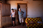 CAETITE, BRAZIL - OCTOBER 25, 2013:<br /> Amelia Silva, 78, with her daughter-in-law Maria da Silva, and their family agreed to be paid $250 a month to permit Renova Energia with wind turbines on their 46-acre land. A string of wind-turbine parks, in the municipal of Caetite, are being erected in the windiest stretches of Bahia state, Brazil, on Friday, Oct 25, 2013. <br /> (Photo by Lianne Milton/For The Washington Post