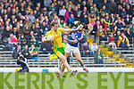 Hand's off: Donegal's Eamon McGee pushes off Paul Galvin during their Allainz league clash in Fitzgerald Stadium on Sunday