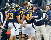 California head coach Jeff Tedford shakes hands with Kevin Riley after making a huge play during the game against ASU at Memorial Stadium in Berkeley, California on October 23rd, 2010.  California defeated Arizona State, 50-17.