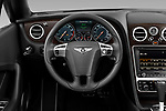 Steering wheel view of a 2013 - 2014 Bentley Continental GTC Convertible.