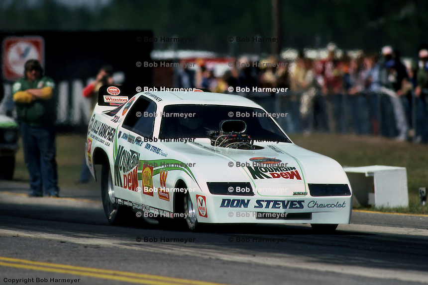 GAINESVILLE, FL - MARCH 13: Funny Car driver John Force leaves the starting line during the NHRA Gatornationals on March 13, 1983, at Gainesville Raceway near Gainesville, Florida.