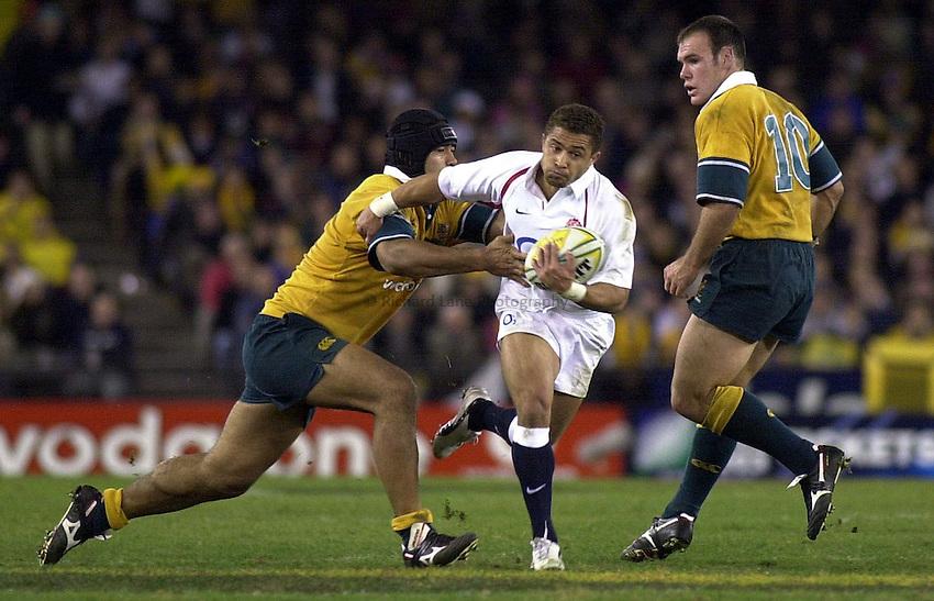 Photo. Steve Holland .Australia v England Rugby Test Match in Melbourne, Australia. 21-06-2003.Jason Robinson dances round the Australian defenders