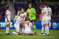 Orlando, FL - Saturday March 24, 2018: Utah Royals goalkeeper Abby Smith (1) speaks to the team while Utah Royals defender Becky Sauerbrunn (4) recovers from an injury during a regular season National Women's Soccer League (NWSL) match between the Orlando Pride and the Utah Royals FC at Orlando City Stadium. The game ended in a 1-1 draw.