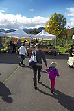 USA, Oregon, Ashland, a mother and her daughter shop locally at the Rogue Valley Growers and Crafters Market