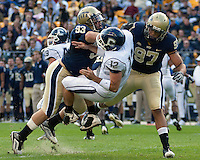 Pittsburgh defensive linemen Gus Mustakas (93) and Jabaal Sheard (97) hit the UConn quarterback Cody Endres .Pittsburgh Panthers defeat the University of Connecticut Huskies 24-21 on October 10, 2009 at Heinz Field, Pittsburgh, PA.