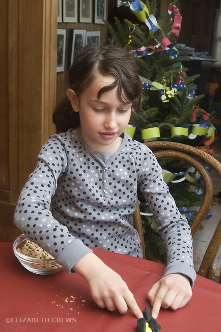 Berkeley CA Girl, seven, modeling object with soft clay at home  MR