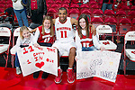 Wisconsin Badgers guard Jordan Taylor (11) poses with fans after a Big Ten Conference NCAA college basketball game against the Illinois Fighting Illini on Sunday, March 4, 2012 in Madison, Wisconsin. The Badgers won 70-56. (Photo by David Stluka)