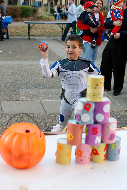 Michael Hiler,6, participates in Can Toss at the Fall Festival hosted on South Campus Thursday afternoon. Photo by Scott Hannigan | Staff