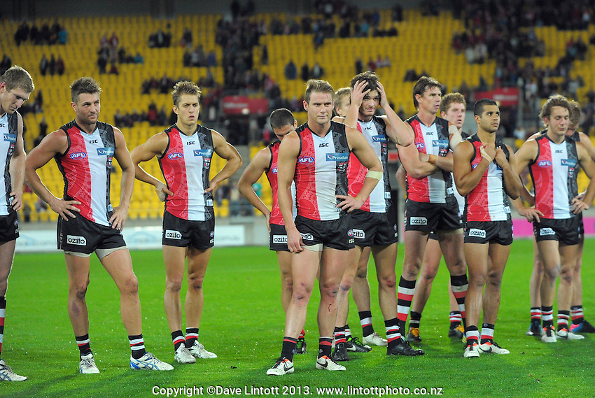 Saints players reflect on the loss after the Australian Rules Football ANZAC Day match between St Kilda Saints and Sydney Swans at Westpac Stadium, Wellington, New Zealand on Thursday, 24 May 2013. Photo: Dave Lintott / lintottphoto.co.nz