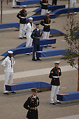 """Arlington, VA - September 11, 2008 -- Joint service troops unveil the Pentagon Memorial Sept. 11, 2008, as the United States Air Force Band plays """"Who Are the Brave."""" The national memorial is the first to be dedicated to those killed at the Pentagon on Sept. 11, 2001. The site contains 184 inscribed memorial units honoring the 59 people aboard American Airlines Flight 77 and the 125 in the building who lost their lives that day..Credit: Jennifer Villalovos - DoD via CNP"""