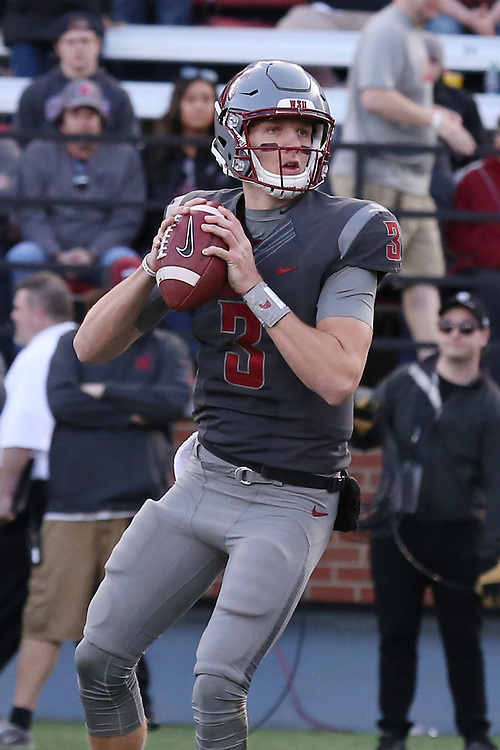 Tyler Hilinski, Washington State quarterback, looks for an open receiver during the Cougars Pac-12 Conference demolition of the Arizona Wildcats, 69-7, on November 5, 2016, at Martin Stadium in Pullman, Washington.
