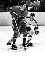 Seals vs Montreal 1970, Pete Mahovlich along side is .Seal Doug Roberts.  (photo/Ron Riesterer)