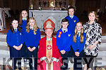 Kilmurry NS Cordal  pupils with Bishop Ray Browne at their Confirmation in St Stephen and John church Castleisland on Thursday  l-r: Abbie Kelliher, Megan Enright, Tara Enright,  Sean Fealy, Bernadette O'mahony, Zoe Smith and Therese Kearney Principal