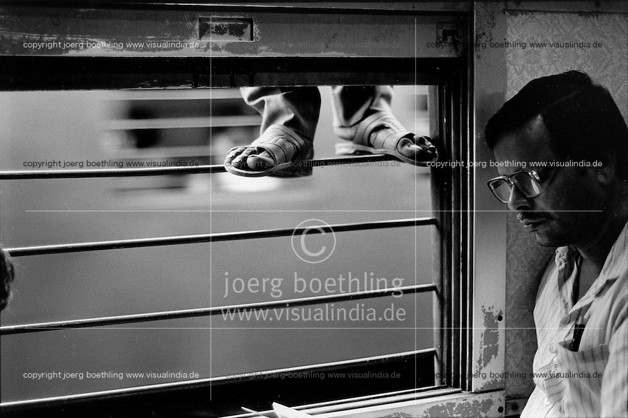 INDIA Mumbai Bombay , inside outside, train surfer and newspaper reader, commuter in crowded trains of western railways , 3 lines transport daily 6 billion people between suburbans and centre of the Megacity  - copyright Joerg Boethling, also as signed black white Baryt fine print available!