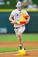 A fan competes in a between innings race where he has to run the bases wearing pool toys during the Carolina League game between the Potomac Nationals and the Winston-Salem Dash at BB&T Ballpark on June 13, 2012 in Winston-Salem, North Carolina.  The Dash defeated the Nationals 5-3.  (Brian Westerholt/Four Seam Images)