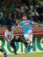Juventus' Patrice Evra   challenges Napoli's Elseid Hysaj during the  italian serie a soccer match,    at  the San  Paolo   stadium in Naples  Italy , September 26 , 2015