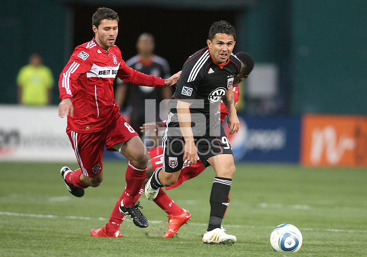 Jaime Moreno #99 of D.C. United races away from Peter Lowry #8 of the Chicago Fire during an MLS match on April 17 2010, at RFK Stadium in Washington D.C. Fire won the match 2-0.