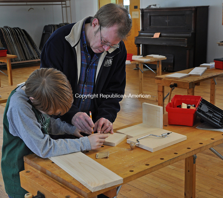 KENT, CT – 08 February 2014 - 020814LMW02 – Cole Branson of South Kent works with his dad, Doug, on his treasure box during the Lost Art Workshop offered Saturday in the First Congregational Church of Kent Parish House. Lynn Mellis Worthington Republican-American