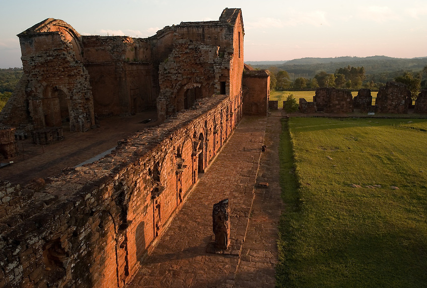 Evening light sweeps over the ruins of the Jesuit mission church at Trinidad de Paraná (Parana with acute accent on final a), Paraguay. Scores of Jesuit missions in the area where Paraguay, Argentina and Brazil meet were built in the 17th century and abandoned when the Jesuits were expelled in the 18th century. Ruins of some of these missions still haunt hilltops in the region. (Kevin Moloney for the New York Times)