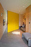 The signature look of this guest bedroom is a massive yellow door