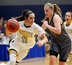 RAPID CITY, SD: DECEMBER 1:  Racquel Wientjes #11 of Black Hills State drives past Sami Steffeck #2 of South Dakota Mines during their Rocky Mountain Athletic Conference women's basketball game Saturday evening at the King Center Rapid City, S.D.  (Photo by Richard Carlson/dakotapress.org)