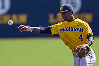 Michigan Wolverines second baseman Ako Thomas (4) makes a throw to first base against the Illinois Fighting Illini during the NCAA baseball game on April 8, 2017 at Ray Fisher Stadium in Ann Arbor, Michigan. Michigan defeated Illinois 7-0. (Andrew Woolley/Four Seam Images)