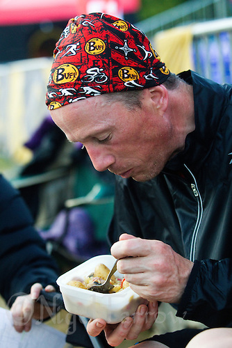11 JUN 2011 - BRANSGORE, GBR - Gerry Duffy stops for some food on day 9 of the Deca Enduroman at the Enduroman Ultra Triathlon Championships (PHOTO (C) NIGEL FARROW)