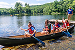 BEACON FALLS, CT. 13 July 2019-071319 - From left, Emily Ruhl, 14, Paige Chiaramonte, 12, Parker Chiaramonte, 9, and Meghan Ruhl, 14, all of Beacon Falls paddle out in a canoe, as Steve Ruhl looks on, during family day at Matthies Park in Beacon Falls on Saturday. Bill Shettle Republican-American