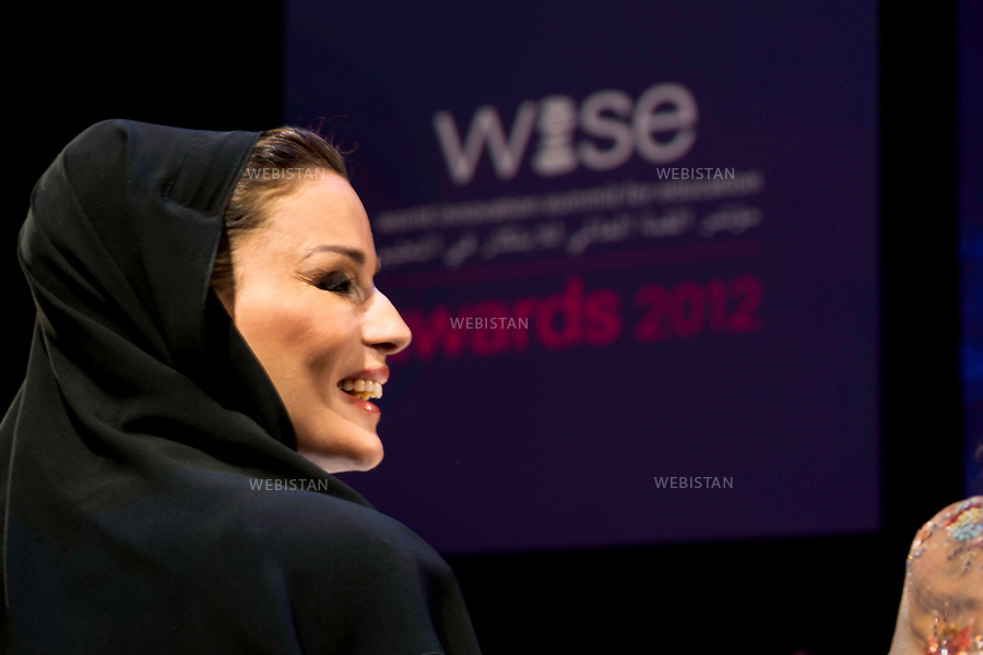 Qatar, Doha, Qatar National Convention Centre <br /> During the World Innovation Submit for Education 2012 (WISE): portrait of Sheikha Mozah bint Nasser Al Missned, second of the three wives of Sheikh Hamad bin Khalifa Al Thani, former Emir of the State of Qatar, from 1995 to 2013 and mother of the current emir, Sheikh Tamim bin Hamad Al Thani. <br /> Founder of the Qatar foundation for education founded in 1996, she presides at the Foundation's annual convention every year. Named UNESCO Special Envoy for Basic &amp; Higher Education in 2013, she oversees all Qatari reforms related to education and the Family Law adopted in 2006 in Qatar. <br /> Qatar is one of the Arab peninsular emirates, on the Persian Gulf shoreline. Bordered by Saudi Arabia, Qatar's economy relies on oil and gas. Being the world's fourth-largest gas exporter, gas remains the major driver of Qatar's economy. The emirate is governed by Sheikh Tamim bin Hamad Al Thani who became at the age of 33 Emir of Qatar on 25 June 25th, 2013 after his father's abdication. He is the youngest emir at the head of an Arab State.<br /> On June 5th, 2017, Saudi Arabia, the United Arab Emirates, Egypt, Bahrain, Yemen, Libya, Mauritania, the Maldives, and Mauritius broke off diplomatic relations with Qatar, accusing the emirate of supporting several terrorist groups. As its Gulf neighbours enforced the closure of all land, air and sea borders to Qatar, the country is quarantined.<br /> 
