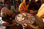 Staff handing out some boiled eggs to women who have brought their under nourished children in from poor villages to a UNICEF feeding centre in Shivpuri, Madhya Pradesh state, India. Despite 15 yeas of economic growth the incidence of child malnutrition has barely changed -- 46 percent of children under 5 in India are malnourished: twice the rate of sub Saharan Africa.. A report released last week said a mixture of poor governance , the caste system dis-empowerment of women and superstition are preventing children from getting the nutrition they need, condemning another generation to brain damage, low earning potential and early death. At the moment 3000 children a day die in India as a result of malnutrition.