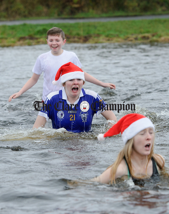Sinead Reidy feels the cold as she ethers the water during the annual Christmas day swim at Gortglas  Lake, Kildysart in aid of the West Clare Mini Marathon Cancer fund. Photograph by John Kelly.