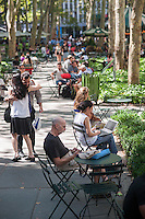 Activity in Bryant Park in New York on Friday, August 21, 2015. (© Richard B. Levine)
