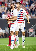 CLEVELAND, OH - JUNE 22: Aaron Long #23 and Walker Zimmerman #5 celebrate the first USA goal during a game between the United States and Trinidad & Tobago at FirstEnergy Stadium on June 22, 2019 in Cleveland, Ohio.