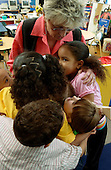 MR / Schenectady, NY.Yates Arts-in-Education Magnet School               .Full day pre-K class; urban public school               .State funding thru NYS Universal Pre-K Program.Teacher and students hug..MR: AE-pkf.©Ellen B. Senisi