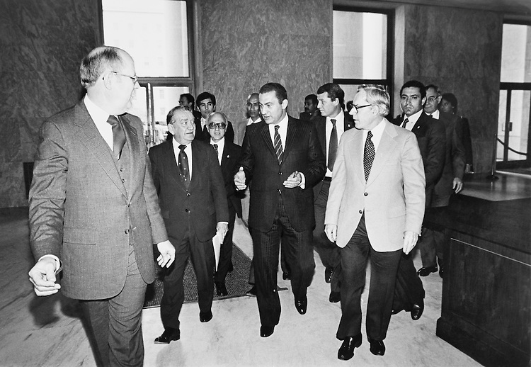 "Rep. William S. ""Bill"" Broomfield, R-Mich., House of Representatives Member, Sen. Jim Guthrie, R-Idaho, President Muhammad Hosni El Sayed Mubarak, NDP-Egypt, and Rep. Clement John Zablocki, D-Wis., House of Representatives Member, going with the Sergeant at Arms to a Foreign Affairs meeting. (Photo by Keith Jewell/CQ Roll Call)"