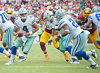 Dallas Cowboys quarterback Dak Prescott (4) looks to hand-off to Dallas Cowboys running back Ezekiel Elliott (21) in fourth quarter action against the Washington Redskins at FedEx Field in Landover, Maryland on Sunday, September 18, 2016.  The Cowboys won the game 27 - 23.<br /> Credit: Ron Sachs / CNP /MediaPunch