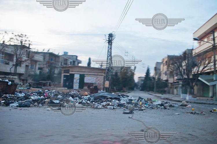 Trashes in the abandoned district of Bab Amr, Homs during a short lull and after heavy bombing all day