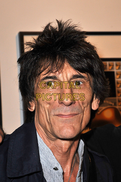 Ronnie Wood.Ronnie Wood attends a Major Retrospective of 50 Years of Rock and Roll. Rolling Stone guitarist, artist and radio DJ chats to press as he unveils a new collection of artworks alongside Rolling Stones artifacts and memorabilia. Features paintings, sketches, handwritten lyrics and guitars. Symbolic London, London, England..August 13th, 2012.headshot portrait blue grey gray top  .CAP/BF.©Bob Fidgeon/Capital Pictures.