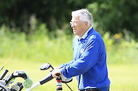 Noel Kelly (Seapoint) who is the caddy for Gerard Dunne (Co. Louth) on the 6th tee during Round 1 of the Irish Amateur Close Championship at Seapoint Golf Club on Saturday 7th June 2014.<br /> Picture:  Thos Caffrey / www.golffile.ie