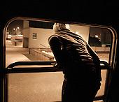 LODZ, FEBRUARY 2012:.Train to Warsaw. Monika waving goodbye to her husband at 4:20am. About 500 thousand people commute everyday from other towns and villages to work in the Polish capital..(Photo by Piotr Malecki / Napo Images)..Lodz, Luty 2012:.Pociag do Warszawy o 4:20 rano. Monika zegna sie z mezem. Okolo 500 tysiecy osob dojezdza codziennie z innych miast do pracy w Warszawie.  .Fot: Piotr Malecki / Napo Images.