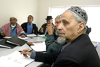 Elderly Yemeni men attend English course at Yemeni Community Centre in Sheffield