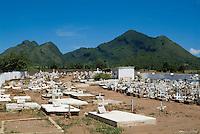 Gravestones in a cemetery on a hot, sunny day, Valle de los Ingenios, Cuba.