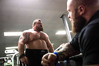 """Eddie """"The Beast"""" Hall jokes with friends during training at his local gym in Stoke-on-Trent."""