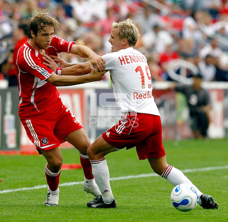 New York Red Bulls midfielder Chris Henderson (19) shoves Chicago Fire midfielder Justin Mapp (21) away from the ball.  The Chicago Fire defeated the New York Red Bulls 2-0 at Toyota Park in Bridgeview, IL on June 25, 2006.